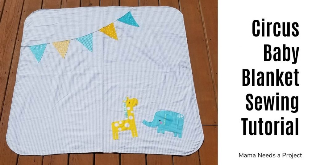 Circus Baby Blanket Sewing Tutorial - photo of blanket with yellow and blue banner and giraffe and elephant sewn on