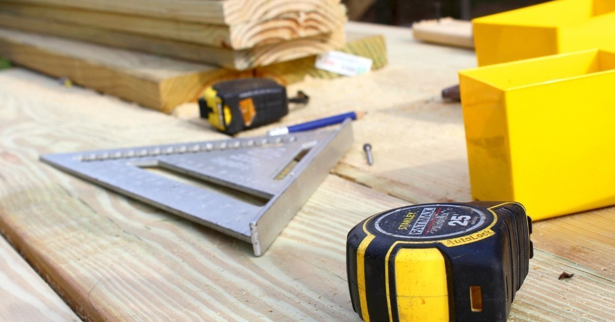 spped square, tape measure, wood, essential woodworking tools