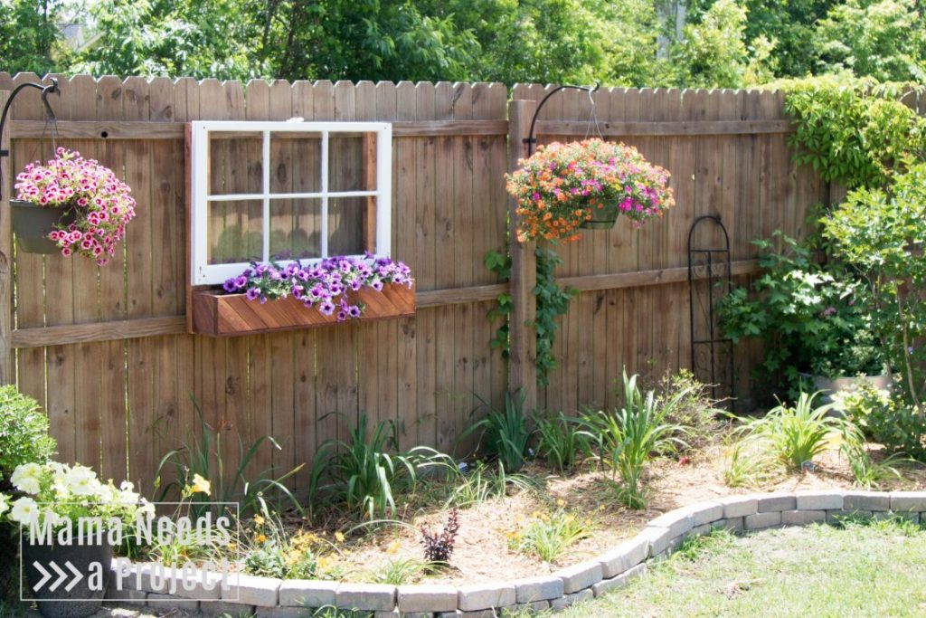 unique garden idea, fence mounted flower box & window