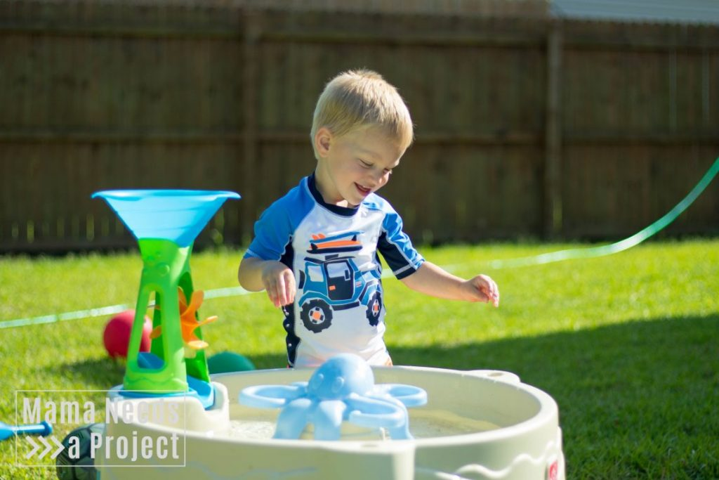 gardening with a toddler, toddler water table outdoor play