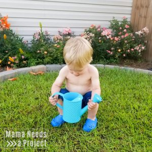 toddler with a watering can, gardening with a toddler