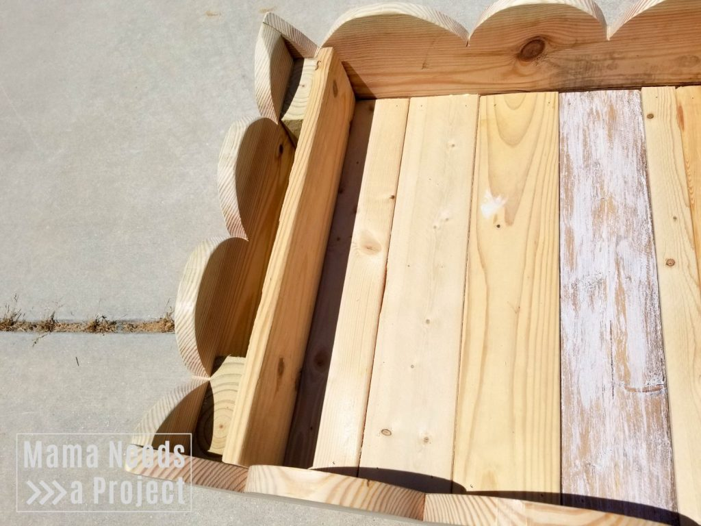 attach trim to woodworking project diy toddler raised flower bed with rainbow