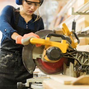 woman using miter saw