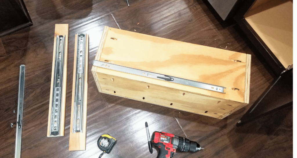 installing drawer slides into a cabinet for a pull out trash