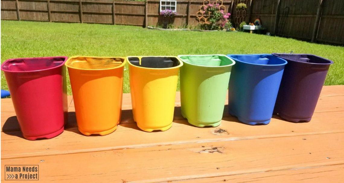 Rainbow painted plastic nursery pots