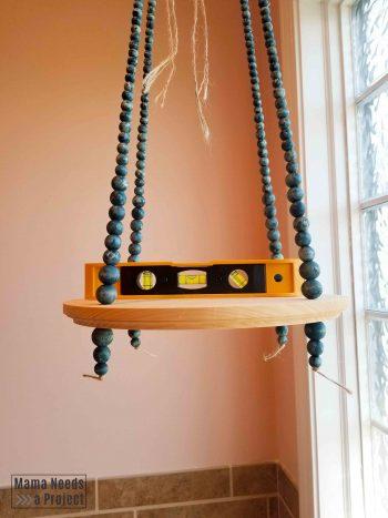 use level to hang diy hanging plant shelf