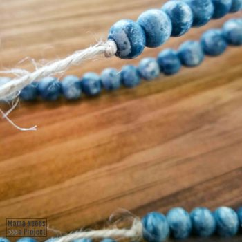 knot tied in jute at end of beads