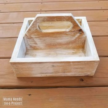 square wood caddy with handle with light brown stain and white paint