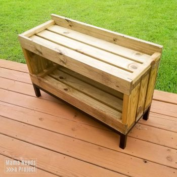 completed diy outdoor toy storage shelf
