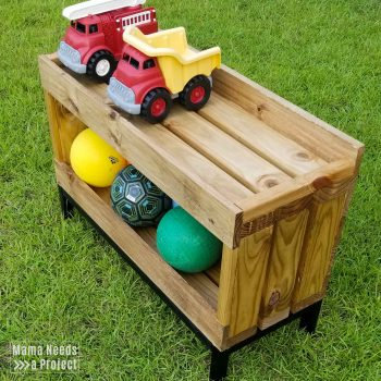 outdoor toy storage shelf with trucks and balls