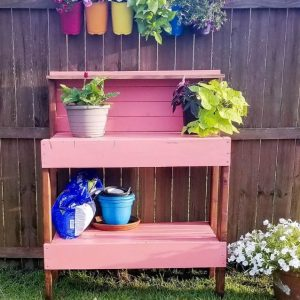 pink potting bench with flowers