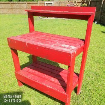 red potting bench for gardening