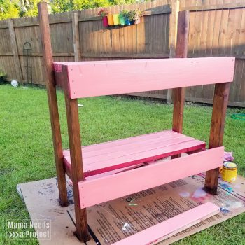 pink and dark wood stain potting bench