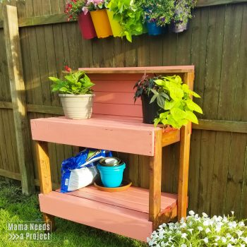 2x4 pink potting bench with flowers and gardening supplies
