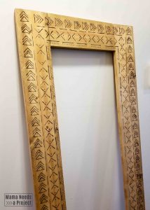 completed diy boho mirror frame with wood burned mudcloth design