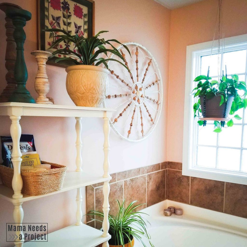 pink boho master bathroom with house plants