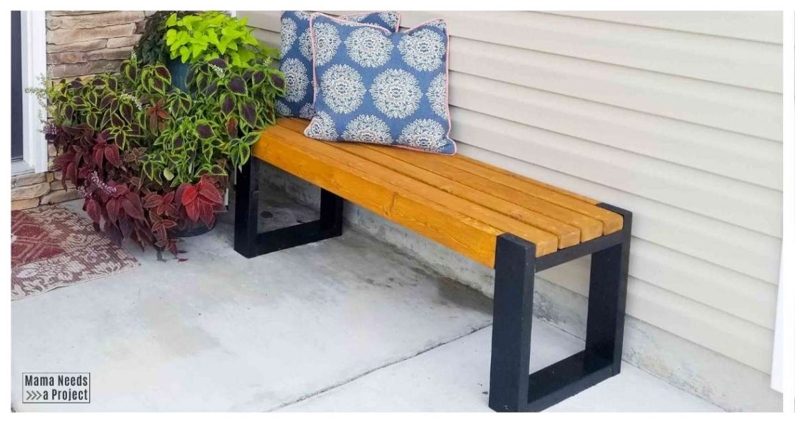 modern 2x4 bench on front porch with plants and pillows