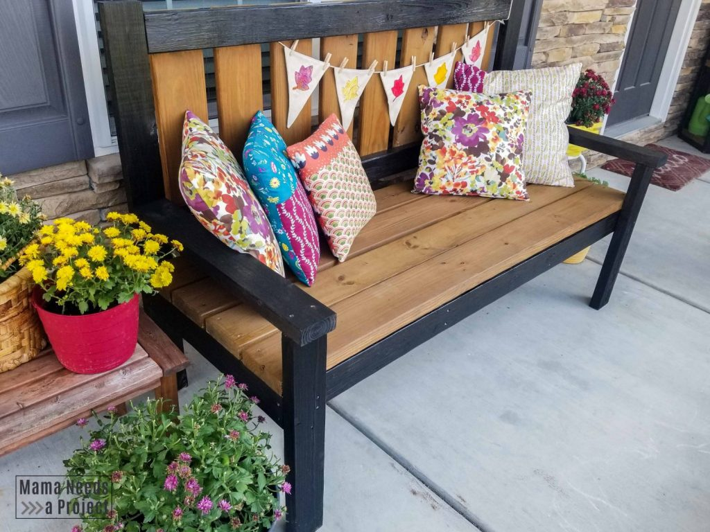 diy outdoor bench with diy pillows and plants