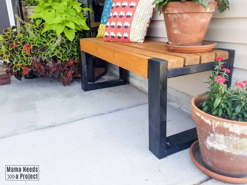 diy front porch bench with flowers and pillows