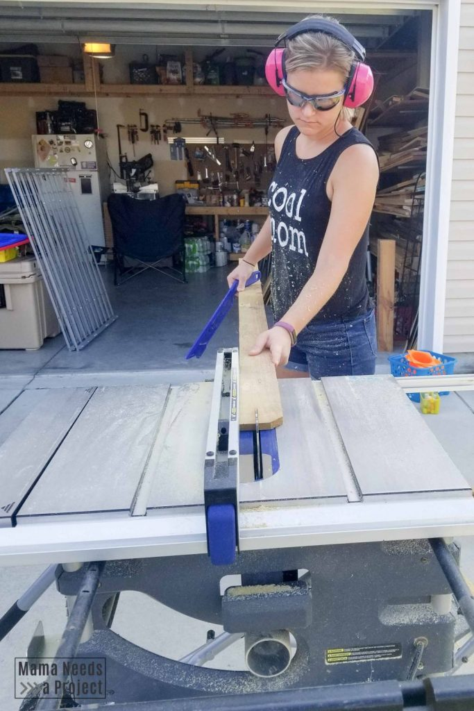 Emilee ripping fence pickets on table saw
