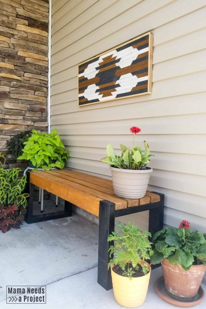 diy geometric wall art on front porch vinyl siding with simple 2x4 bench and flowers