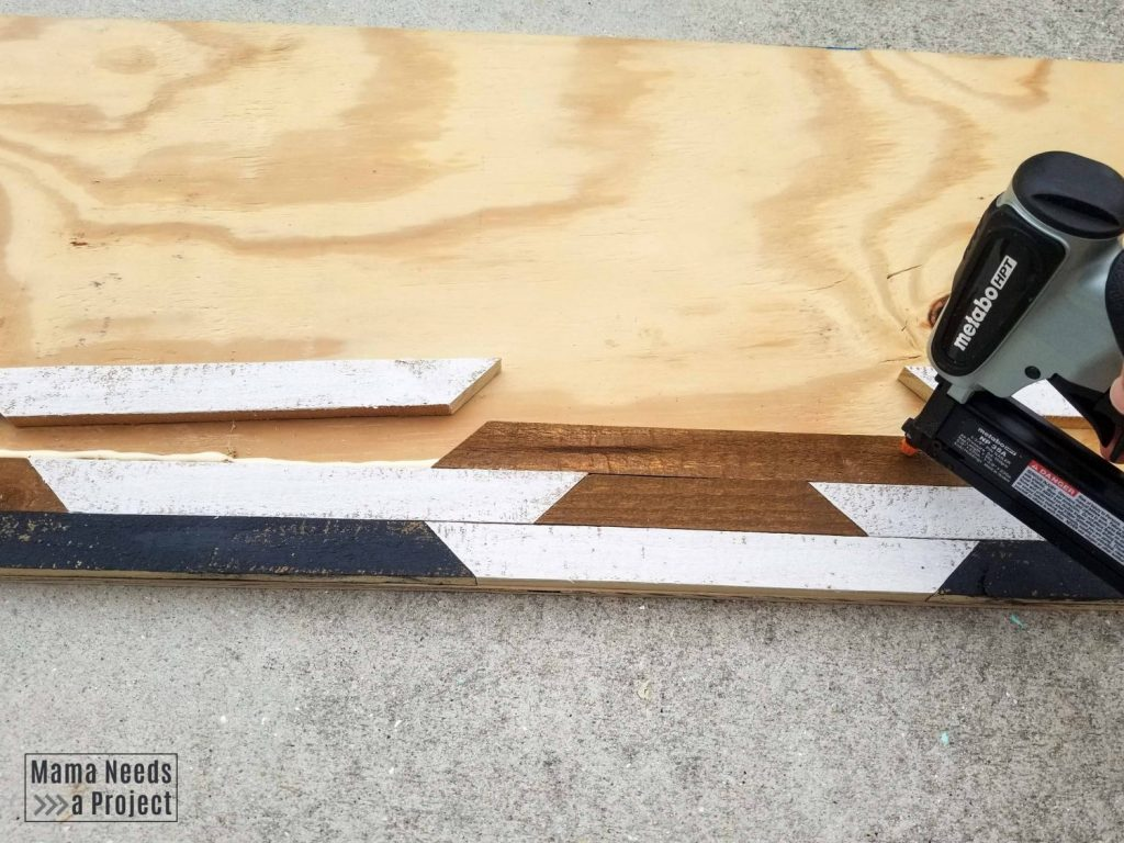 Use pin nailer to secure pieces to plywood backing