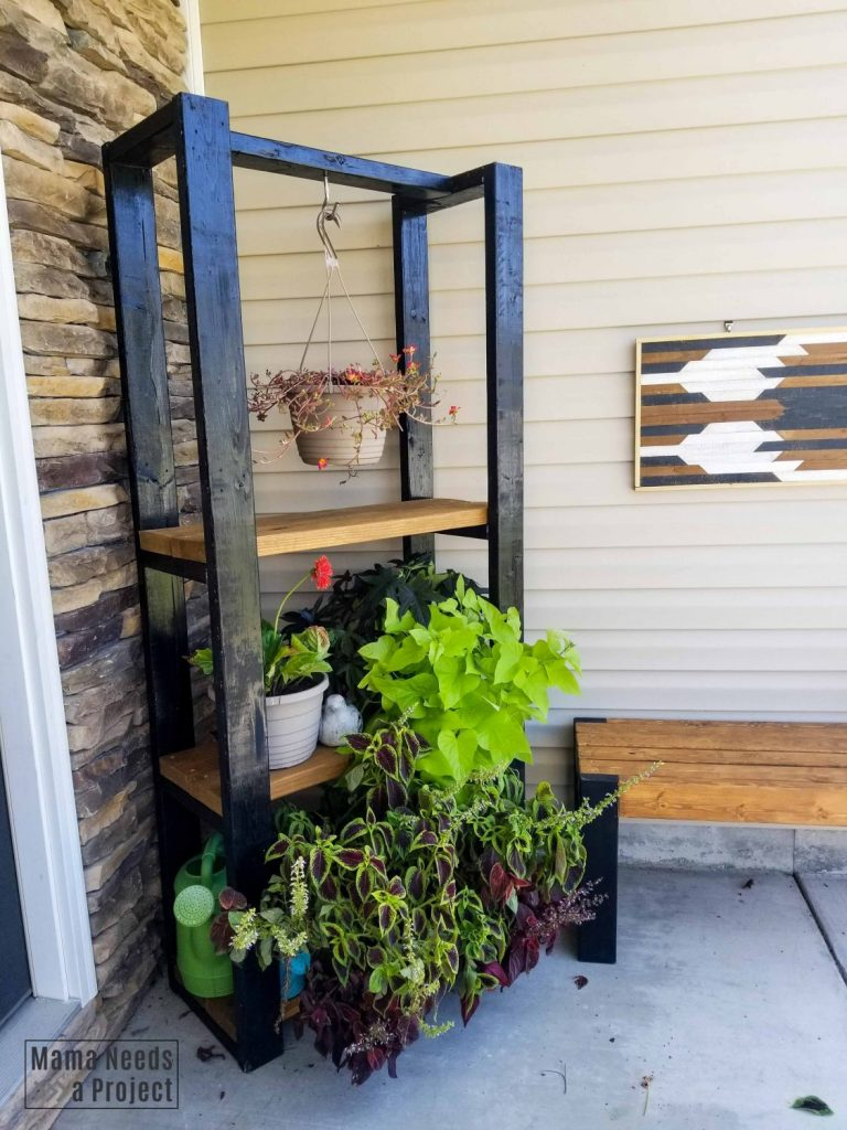 completed diy outdoor plant shelf with other diy outdoor furniture