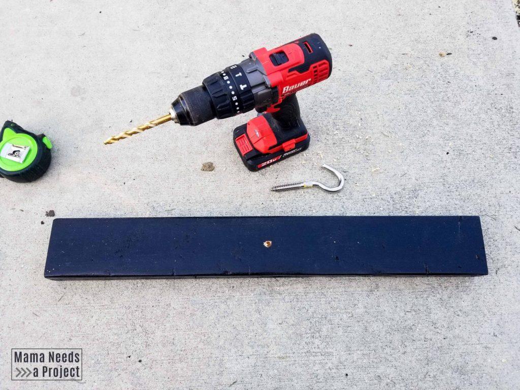 installing hook on diy outdoor plant shelf