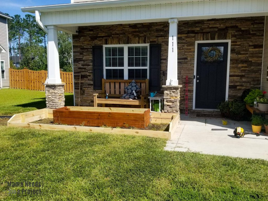 building raised flower bed in front of home, under construction