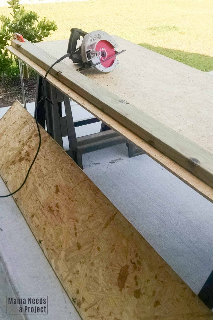 circular saw with DIY guide to cutting a large piece of plywood
