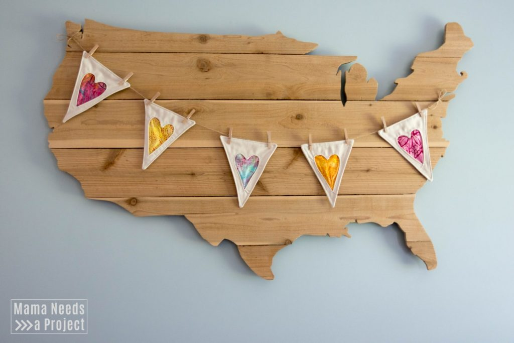 large wood USA map with heart banner