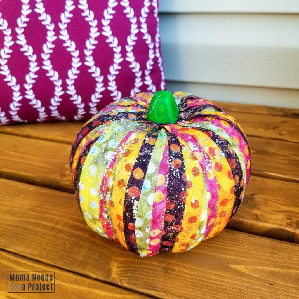 scrap fabric pumpkin with glitter top coat