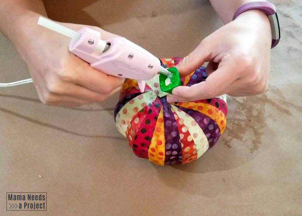 use hot glue gun to add stem to scrap fabric pumpkin