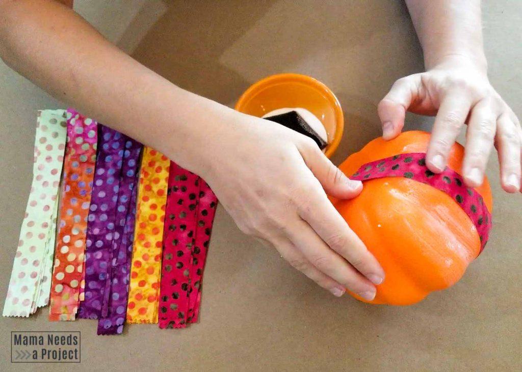 add fabric to mod podge on foam pumpkin