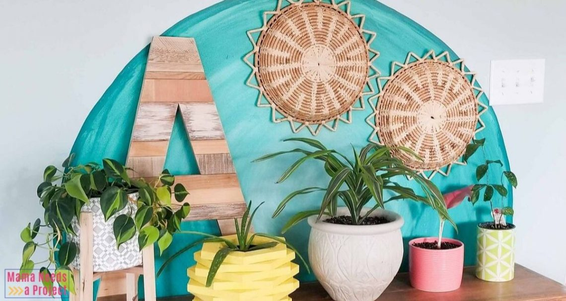 Watercolor inspired teal circle on wall with eclectic decor