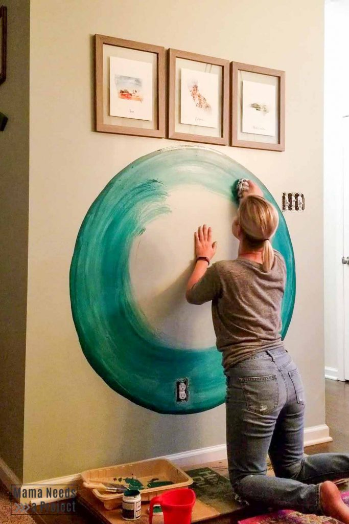 continue to blend paint with rag for diy watercolor wall paint technique
