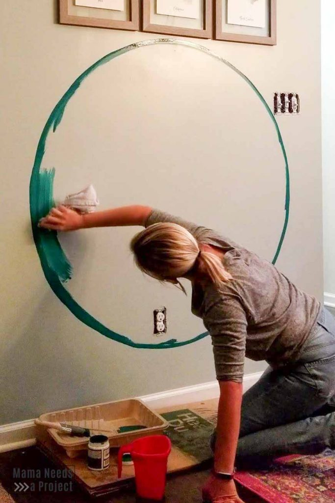 use rag to add paint inside circle for diy watercolor wall paint technique