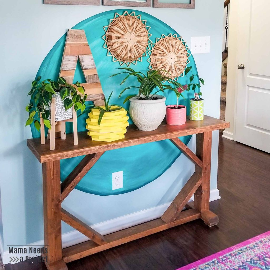 bright teal diy watercolor wall circle with colorful decor and plants