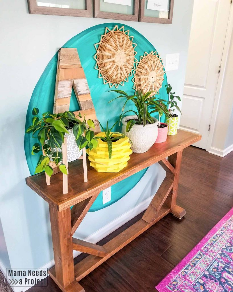 bright teal circle painted on wall with colorful boho eclectic decor