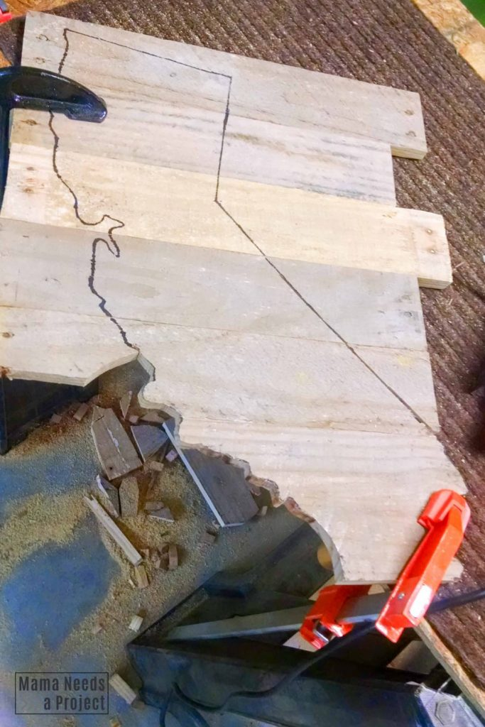 clamped wood, cutting out outline with a jigsaw