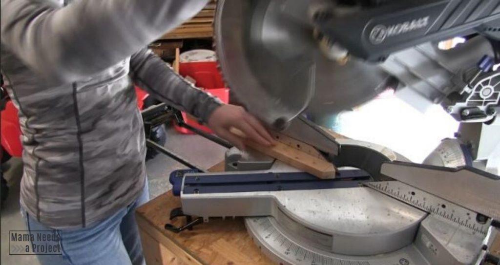 Cut 1x2 into arrow shape with a miter saw