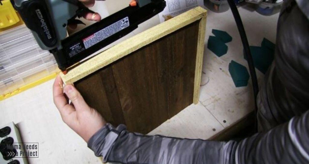 nail frame to backing of scrap wood snowflake