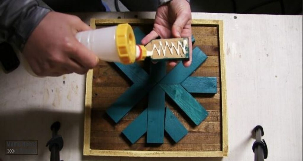 use wood glue and a pin nailer to attach snowflake