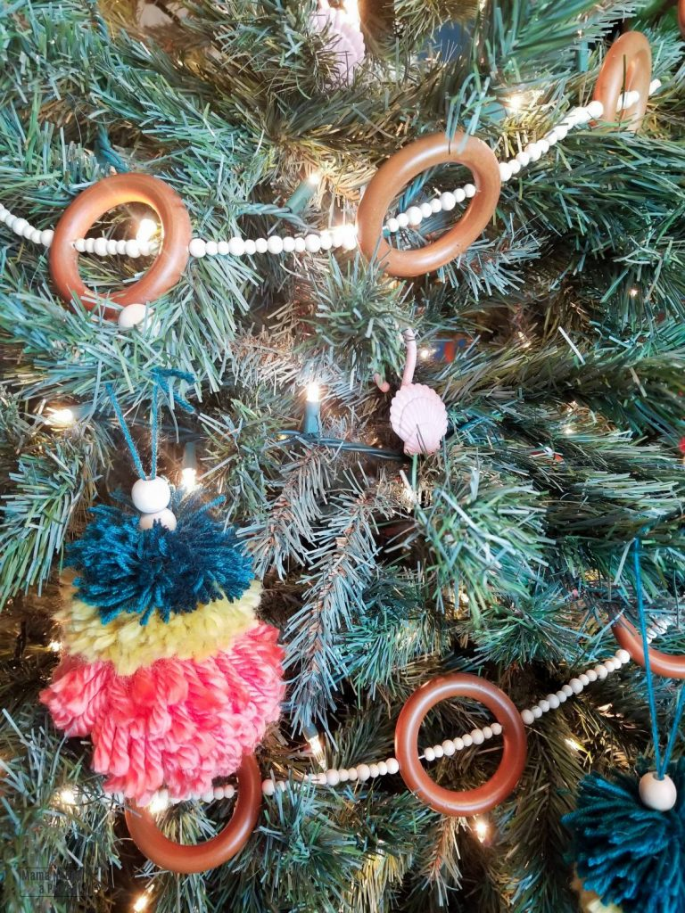 diy wooden bead and ring garland on a christmas tree