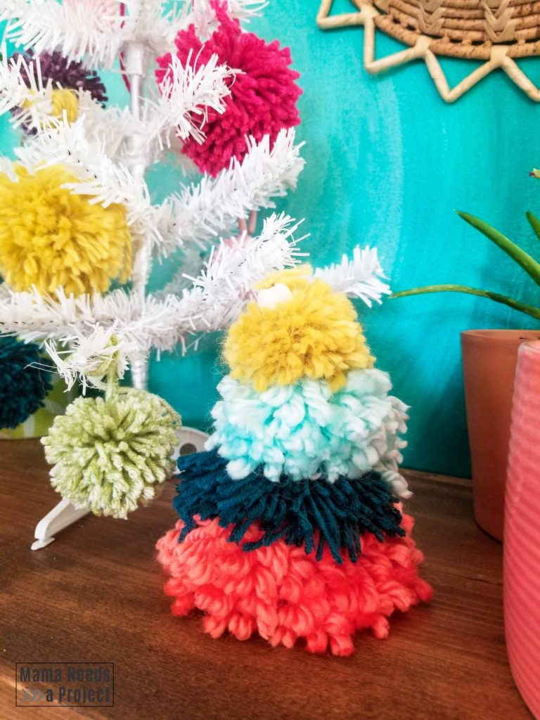 DIY boho pom pom christmas tree with a bead on the top