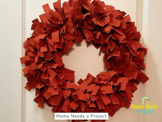 orange rag wreath made from a linen table