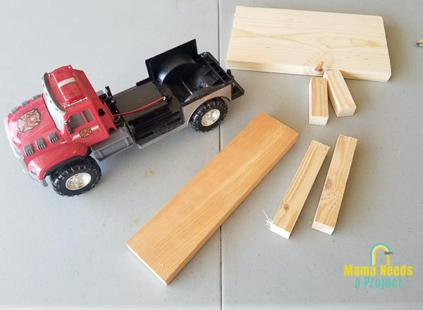 disassembled toy firetruck and wood for cupcake stand