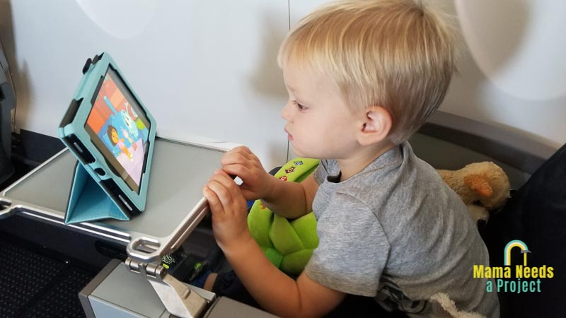 toddler watching a movie on an airplane