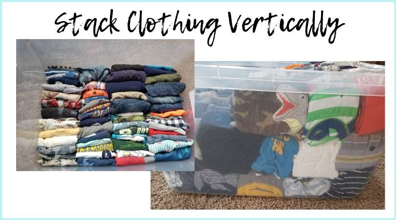 stacking baby clothes folded konmari style vertically into storage bins