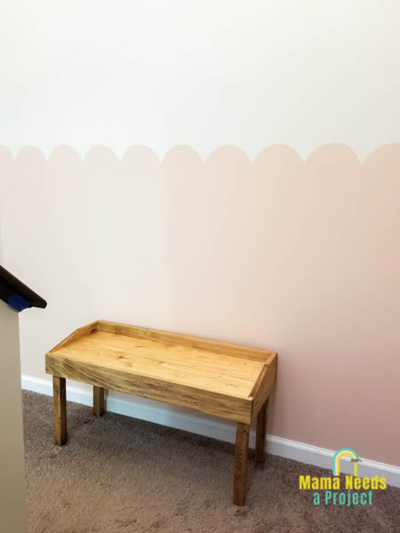 pink painted scalloped wall with diy small modern bench in front